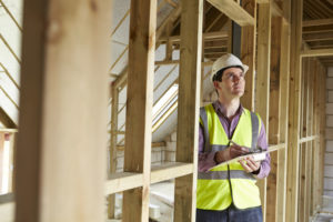 Building Inspector Looking At New Property | Staffordshire Home Advisors | Marietta GA Home Inspections
